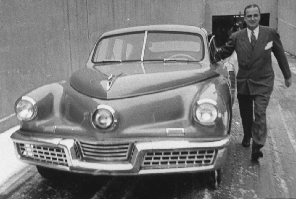automobile and tucker Tucker torpedo brochure, c 1947 this concept drawing includes a centrally positioned steering wheel, doors that wrap up into the roof, and front fenders that turn.