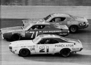 A.J. Foyt (21), Buddy Baker (71) and Richard Petty (43) race three abreast on the Banked oval of Texas World Speedway as they try for the lead of the 1972