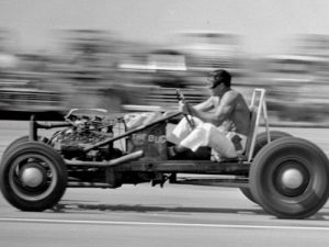"The ""Bug"", generally considered to be the first rail dragster, raced for the first time. Dick Kraft was the driver."
