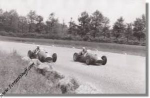 Alberto Ascari in his # 2 Ferrari 375 and Froilan Gonzales in his # 6 Ferrari 375 heading for a 1 - 2 victory during the 1951 Italian Grand Prix.