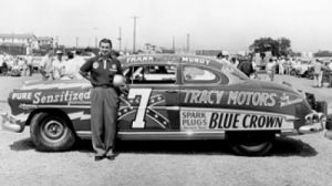 "Frank ""Rebel"" Mundy poses with his highly successful Hudson Hornet."